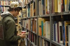 Sam Hagen peruses through books